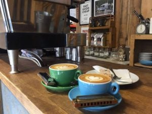 Flat whites and harmonicas in a speciality coffee shop